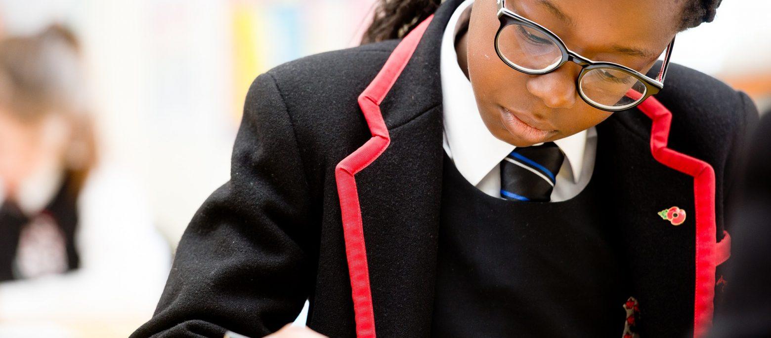 A school girl focusing on her studies