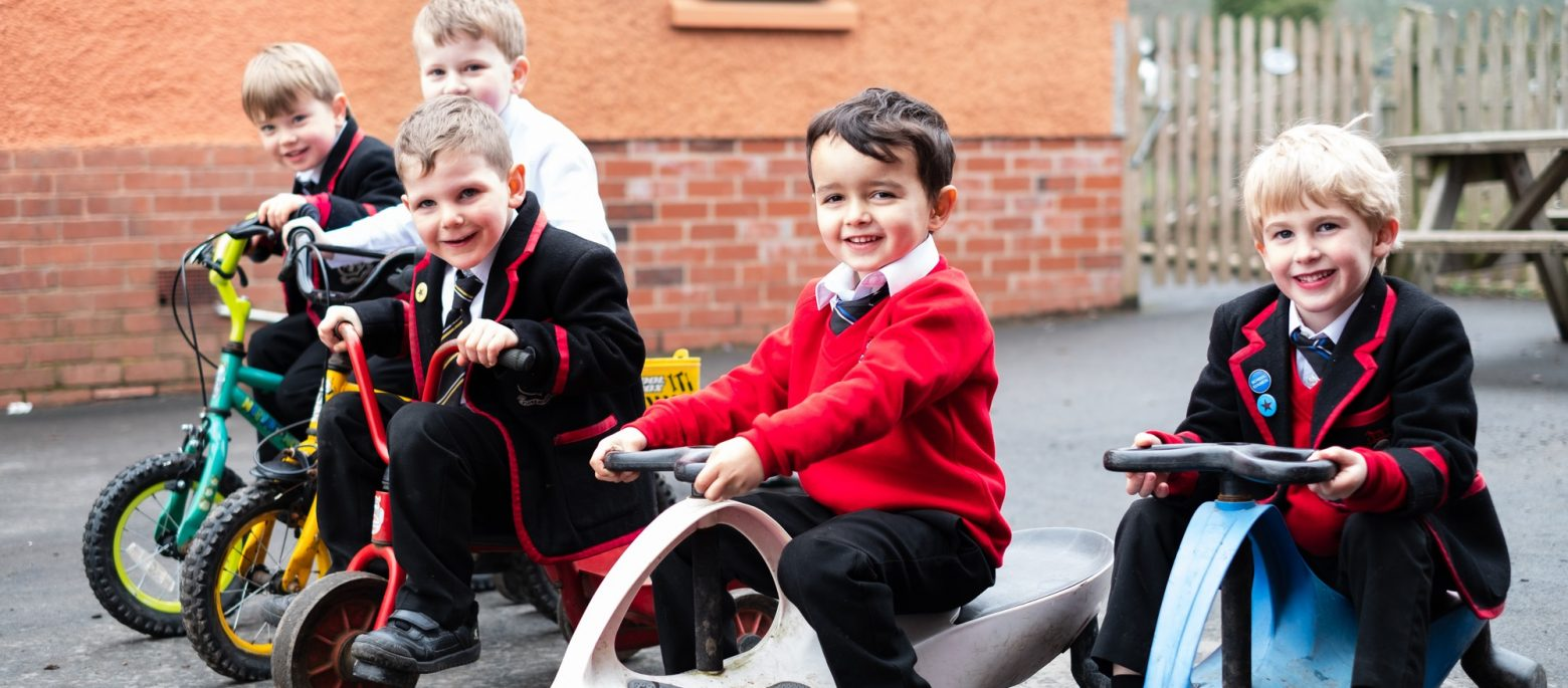 Lucton School children on bikes and trikes in playground