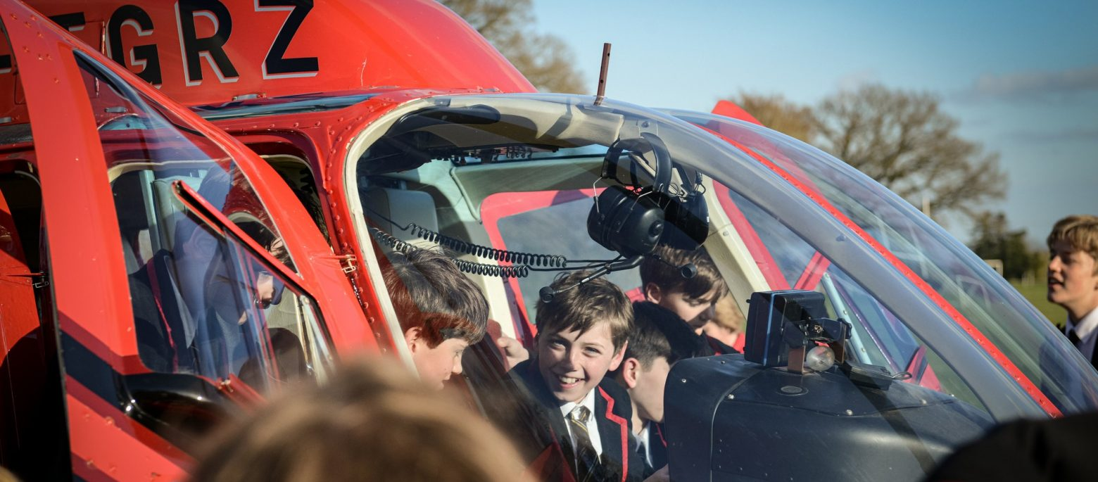 Children enter the helicopter