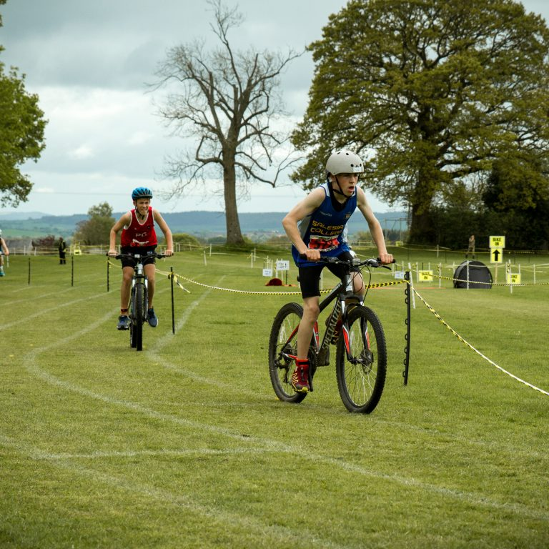 A group of boys completing the school triathlon