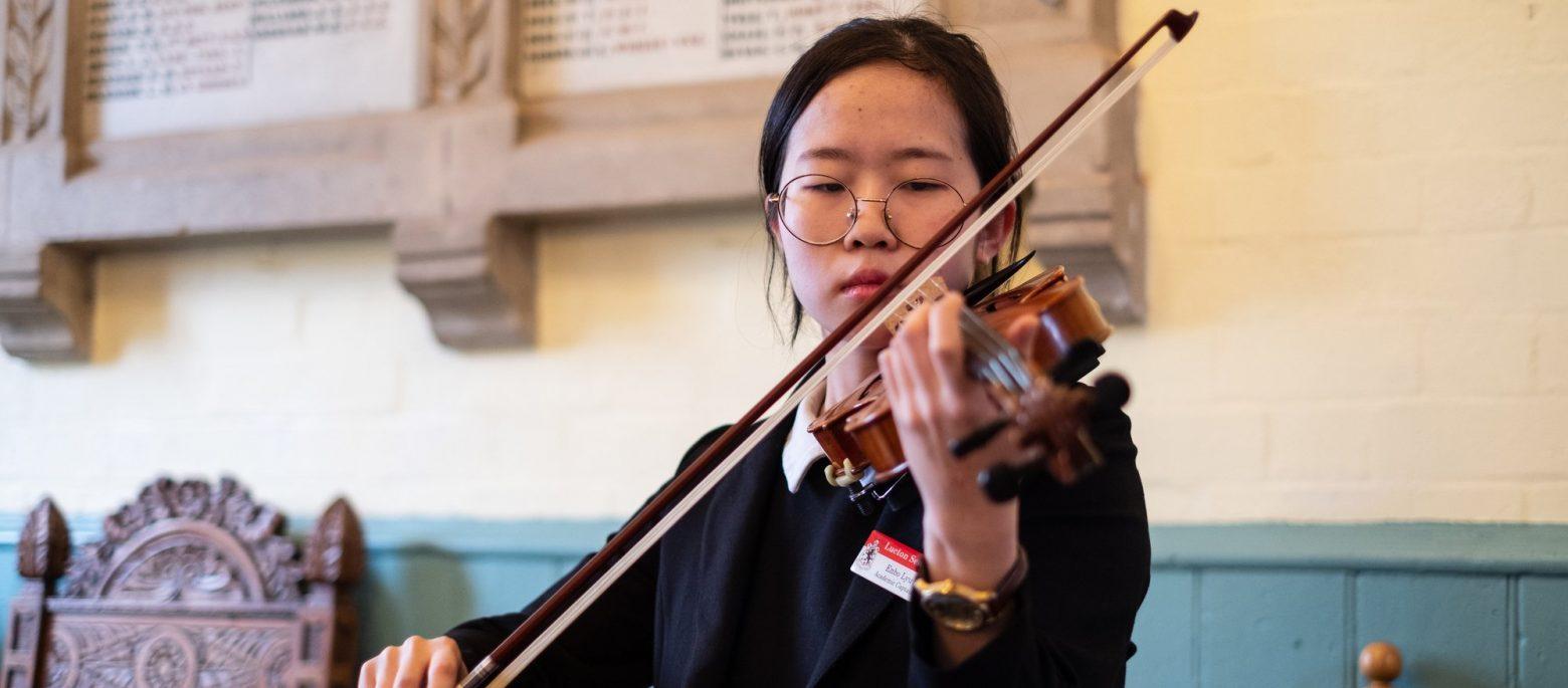 school girl playing violin