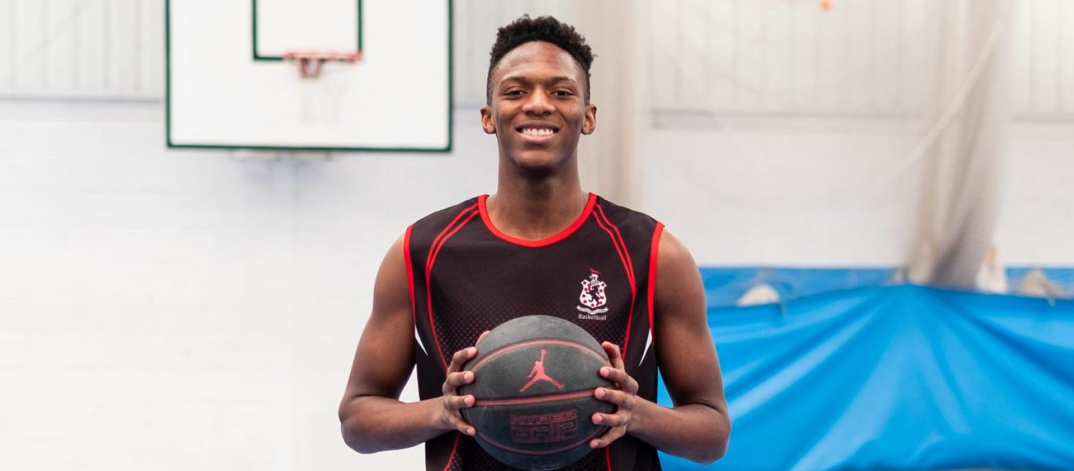 Student holding basketball